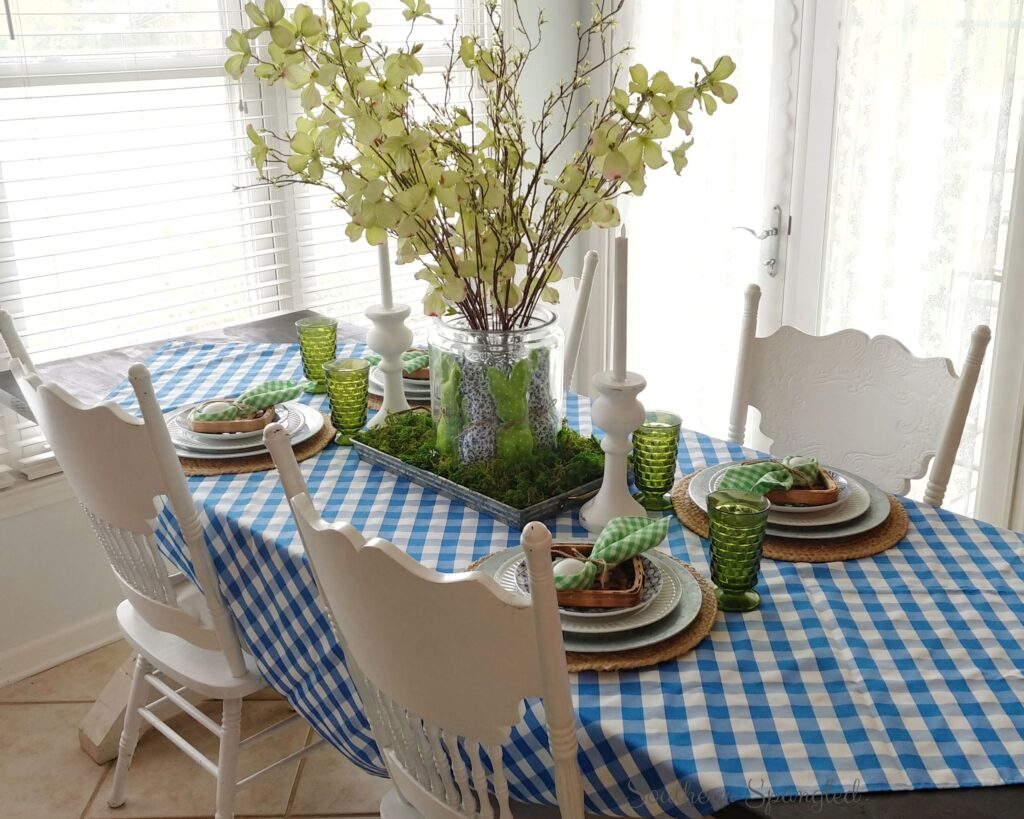 Blue and green Easter tablescape with bunnies and vintage glassware